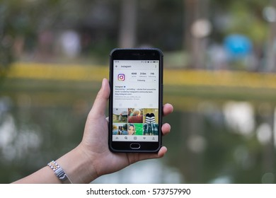 CHIANG MAI, THAILAND - FEB 7,2017: Woman holding Smartphone and using Instagram application on the screen.Instagram is largest and most popular photograph social networking.