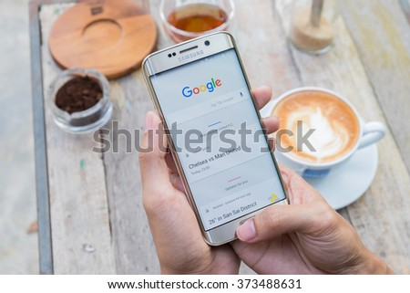 CHIANG MAI, THAILAND - FEB 8 2016 : A man hand holding screen shot of google search. Google is an American multinational corporation specializing in Internet-related services and products.