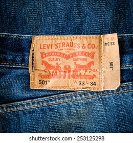 CHIANG MAI, THAILAND- FEBRUARY 15, 2015 - Closeup of old leather like heavy card stock label of a pair of Levi's brand of denim jeans. Levi Strauss & Co. is a worldwide clothing corporation.