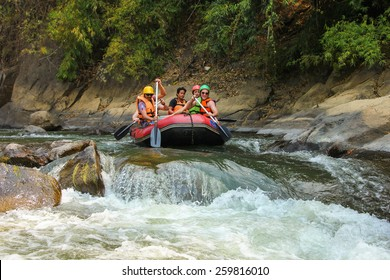 CHIANG MAI, THAILAND - FEBRUARY 16 : White water rafting on the rapids of river Maetang on FEBRUARY 16, 2015 in Chiang Mai, Thailand.  Maetang river is one of the most dangerous rivers of Thailand.