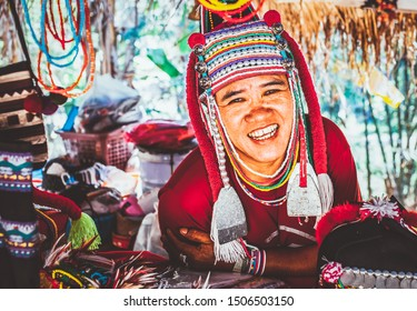 CHIANG MAI THAILAND- FEBRUARY, 2019 : Akha woman selling her goods in Baan Tong Luang eco village near Chiangmai,Thailand. Akha people arrived to Thailand from Myanmar and now live in villages across