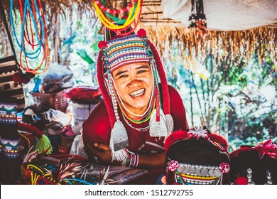 CHIANG MAI THAILAND- FEBRUARY, 2019 : Akha woman selling her goods in Baan Tong Luang eco village near Chiangmai,Thailand. Akha people arrived to Thailand from Myanmar