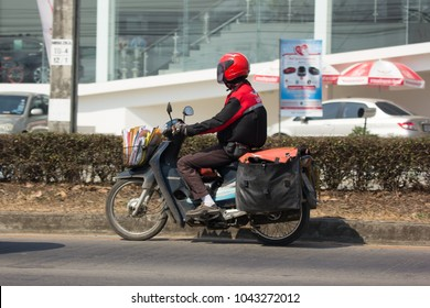 CHIANG MAI, THAILAND -FEBRUARY 27 2018: Postman and Motercycle of Thailand Post. Photo at road no.121 about 8 km from downtown Chiangmai, thailand.