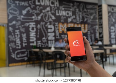 CHIANG MAI, THAILAND - JAN. 06,2019: Man holding HUAWEI with alibaba apps on screen. Alibaba's the the world's biggest online commerce company. It's three main sites Taobao,Tmall and Alibaba.
