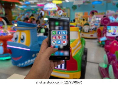 CHIANG MAI, THAILAND - JAN. 06,2019: Man holding Apple iPhone 6S Rose Gold with icons of social media on screen. Social media are most popular tool. Smartphone lifestyle. Starting social media app.