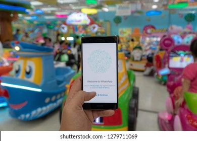 CHIANG MAI, THAILAND - JAN. 06,2019: Man holding OnePlus 6 with Whatsapp messenger on the screen.WhatsApp Messenger is a FREE messaging app to let you message and call friends and family.