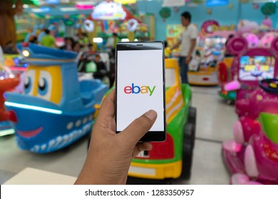 CHIANG MAI, THAILAND - JAN. 06,2019: Man holding HUAWEI with eBay apps on the screen. eBay is one of the most popular ways to buy and sell goods and services on the internet.