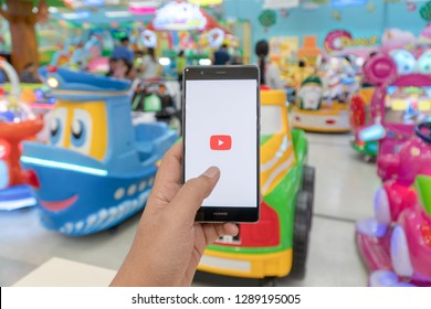 CHIANG MAI, THAILAND - JAN. 06,2019: Man holding HUAWEI with Youtube apps on screen. YouTube is the popular online video sharing website.