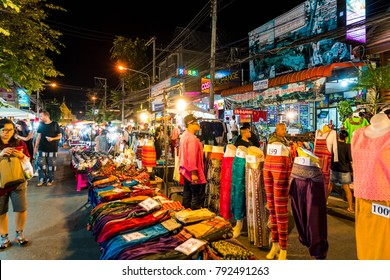 Chiang Mai, Thailand - Jan 1, 2018 : Tourists traveling at Night Market in Chiang Mai, Thailand.