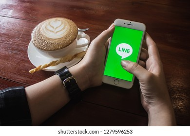 CHIANG MAI, THAILAND - JAN 10 2019: Woman holding iphone 6s with LINE apps on screen. LINE is a new communication app which allows you to make free voice calls and send free messages.