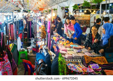 CHIANG MAI, THAILAND - JAN 11, 2017: People at a Night Market in Chiang Mai. Chiang Mai is a second largest city of Thailand. Famous tourist destination