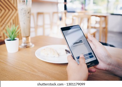 CHIANG MAI, THAILAND - JAN. 19,2019: Woman holding HUAWEI mobile phone with Linkedin application on the screen. Linkedin is a business and employment oriented social networking service.