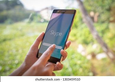 CHIANG MAI, THAILAND - JAN. 19,2019: Woman holding HUAWEI with skype apps. Skype is part of Microsoft, can make video, audio calls, chat messages and do much more using Skype.