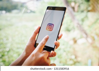 CHIANG MAI, THAILAND - JAN. 19,2019: Woman holding HUAWEI with Instagram application on the screen. Instagram is a popular online social networking service.