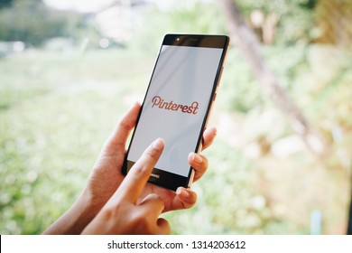 CHIANG MAI, THAILAND - JAN. 19,2019: Woman holding HUAWEI mobile phone with Pinterest apps on screen. Pinterest is an online pinboard that allows people to pin their interesting things.