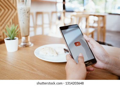 CHIANG MAI, THAILAND - JAN. 19,2019: Woman holding HUAWEI with Youtube apps on screen. YouTube is the popular online video sharing website.