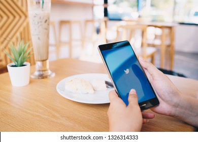 CHIANG MAI, THAILAND - JAN. 19,2019: Woman holding HUAWEI with Twitter app on the screen.Twitter is an online news and social networking service where users post and interact with messages.