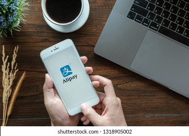 CHIANG MAI, THAILAND - Jan 20, 2019 : Male holding iPhone 6s  with Alipay logo, Alipay is application from china