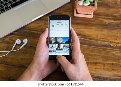CHIANG MAI, THAILAND - JAN 20, 2017: A man hand holding iphone with new logo of instagram application. Instagram is largest and most popular photograph social networking.