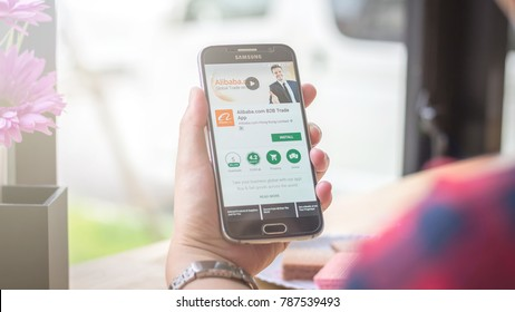 Chiang Mai, Thailand - January 06, 2018 : Samsung Galaxy S6 smartphone launches alibaba aliexpress application on the desk screen at the coffee shop.