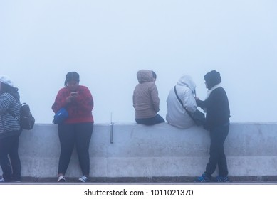 Chiang Mai, Thailand - January, 13, 2018 : Unidentified name Visitors to watch the sunrise at the point of view km 42 in the winter season foggy day at Doi Inthanon National Park, Chiang Mai,Thailand.
