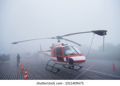 Chiang Mai, Thailand - January, 13, 2018 : Helicopter landing at the parking lot can not fly due to bad weather, very foggy at Doi Inthanon National Park, Chiang Mai,Thailand.
