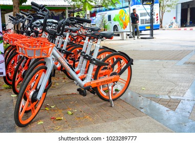 Chiang mai, Thailand - January 13, 2018 : city bike, a row of Mobike parking on footpath, Mobike is a network of rental and sharing public bicycle in Chiang mai, Thailand for helps to reduce traffic