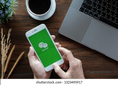 CHIANG MAI, THAILAND - January 20, 2019 : Man holds iphone 6 with WeChat app on the screen.WeChat is a Chinese multi-purpose messaging, social media and mobile payment app