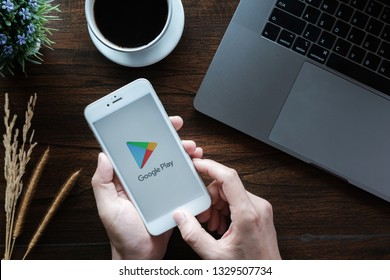 CHIANG MAI, THAILAND - January 20,2019 : A Man holds iphone 6 with Google Play application on the screen in coffee shop. Google Play is an app store for the ios system