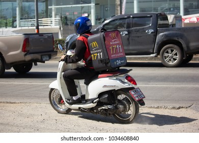 CHIANG MAI, THAILAND -JANUARY 22 2018:   Delivery service man ride a Motercycle of Mcdonale. On road no.1001, 8 km from Chiangmai city.