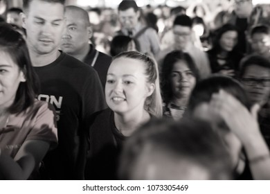 CHIANG MAI THAILAND - JANUARY 29; Gritty blurry monochrome long exposure effect of faces of crowd of people in night street scene illuminated January 29 2018 Chiang Mai Thailand