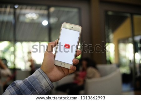 Chiang mai, Thailand - January 30 2017 : Man in blue plaid wear holding iphone 6 white color with youtube application logo on screen, copy space, for presentation product