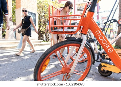 CHIANG MAI, THAILAND - JANUARY 31, 2019_Mobike parked on footpath in Chiang Mai, Thailand. Mobike is a bike sharing service that you can pick up and leave a bike wherever you need to go.