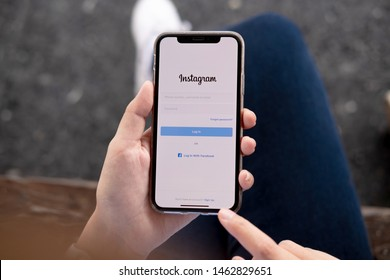 CHIANG MAI, THAILAND - JUL 26, 2019: A woman holds Apple iPhone XSwith Instagram application on the screen at cafe. Instagram is a photo-sharing app for smartphones.