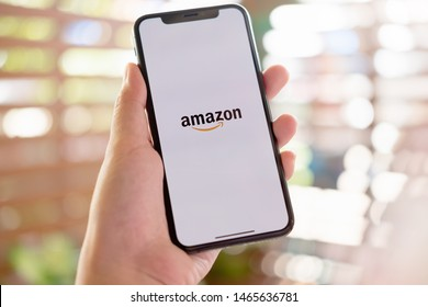 CHIANG MAI, THAILAND, JUL 27, 2019 : iPhone Xs showing Amazon logo shopping online. Amazon.com, Inc. American international electronic commerce company.