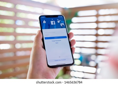 CHIANG MAI, THAILAND, JUL 27, 2019 : Facebook social media app logo on log-in, sign-up registration page on mobile app screen on iPhone smart devices in business person's hand at work