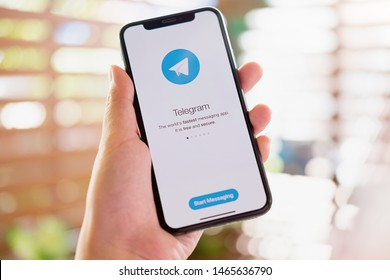 CHIANG MAI, THAILAND, JUL 27, 2019 : Woman hand holding iPhone X with social networking service Telegram on the screen. iPhone 10 was created and developed by the Apple inc.