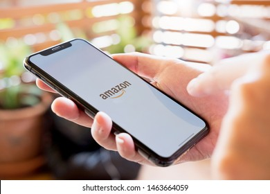 CHIANG MAI, THAILAND - JUL 28 2019: Woman hands holding iphone Xs with Amazon apps. Amazon is an American international electronic commerce company. It's the world's largest online retailer.