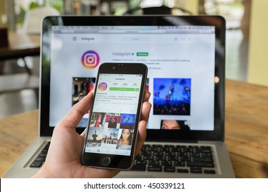 CHIANG MAI, THAILAND - JULY 10, 2016: A women hand holding iphone with new logo of instagram application. Instagram is largest and most popular photograph social networking.
