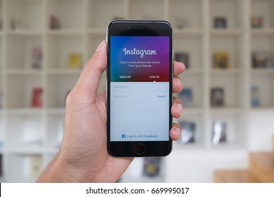 CHIANG MAI, THAILAND - JULY 1,2017: A man holds Apple iPhone with Instagram application on the screen. Instagram is a photo-sharing app for smartphones.