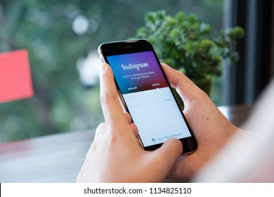 CHIANG MAI, THAILAND - July 13, 2018: Woman hands holding iPhone with Instagram application on the screen. Instagram is a popular online social networking service.