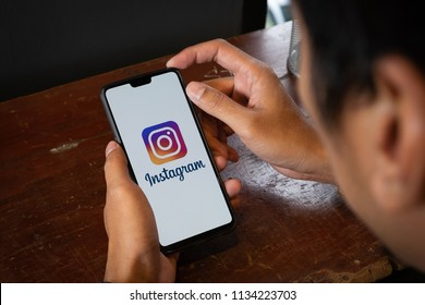 CHIANG MAI, THAILAND - JULY 14, 2018: A man hand holding Oneplus with logo of instagram application. Instagram is largest and most popular photograph social networking.