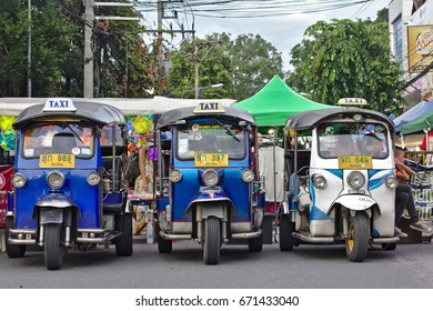 CHIANG MAI, THAILAND - July 2, 2017: Tuk Tuk drivers are waiting in line for customers at 'Walking Street' in Chiang Mai's old town district.