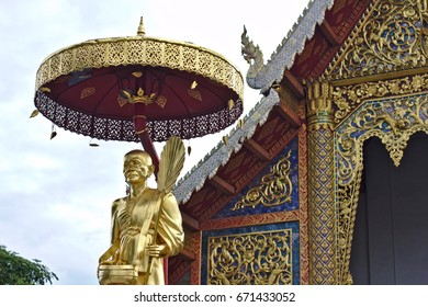 CHIANG MAI, THAILAND - July 2, 2017: The golden statue of a monk in front of one of Chiang Mai's most famous temples, Wat Phra Singha.