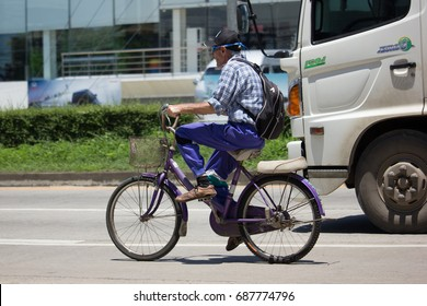 CHIANG MAI, THAILAND - JULY 27  2017:  Private Bicycle with old man on Highway Road.   On road no.1001, 8 km from Chiangmai city.
