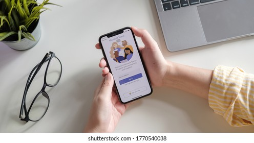 CHIANG MAI, THAILAND - JULY 3, 2020 : A working from home employee is downloading the Microsoft Teams social platform, ready for remote working in isolation from home.