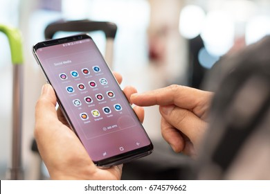 Chiang Mai, THAILAND - July 4, 2017: Woman lifestyle relaxing using smartphone Samsung Galaxy S8 with icons of social media on screen, smart phone life style, mobile phone era in everyday life