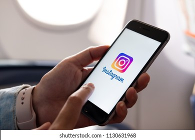 CHIANG MAI, THAILAND - JULY 6 2018: Woman hand holding iphone with logo of instagram application. Instagram is largest and most popular photograph social networking.