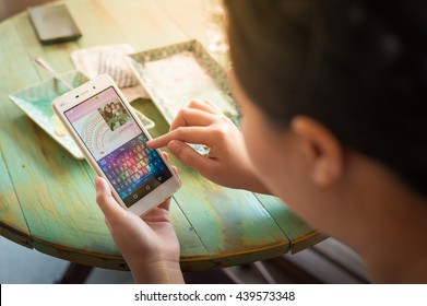 CHIANG MAI, THAILAND - JULY 7,2016: Young woman using Line app on Wiko smartphone for social networking. Line Messenger is a free instant communication application for mobile devices from NAVER