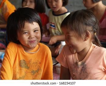CHIANG MAI, THAILAND - JUN. 12: Poor children in countryside on June 12, 2009 in Chiang Mai, Thailand.